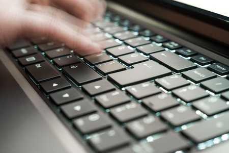 finger: Hands on laptop keyboard, fast typing