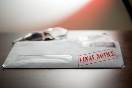 stealth: Final notice rubber stamp on letter envelope