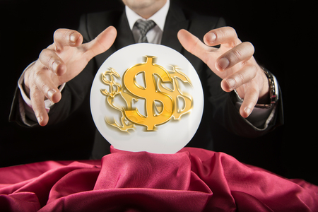 prognosticator: Fortune teller businessman, sees the dollar in a crystal ball Stock Photo