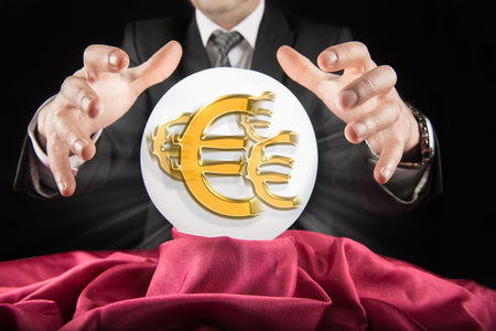 prognosticator: Fortune teller businessman, sees the Euro sign in a crystal ball Stock Photo