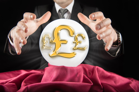 prognosticator: Fortune teller businessman, sees the pound - sterling sign in a crystal ball