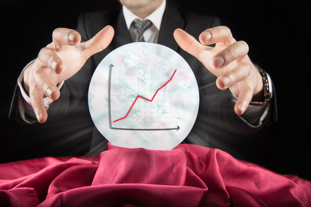 seer: Fortune teller businessman, sees the rising graph of a crystal ball