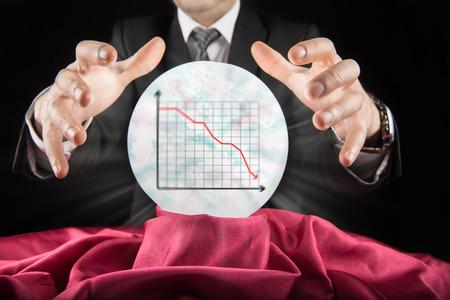 prognosticator: Fortune teller businessman, sees falling graph of a crystal ball