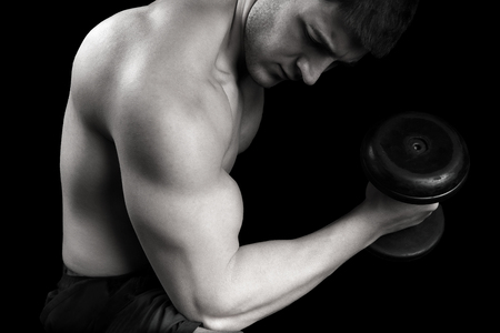 only the biceps: Healthy Man Exercising with Weights Arm