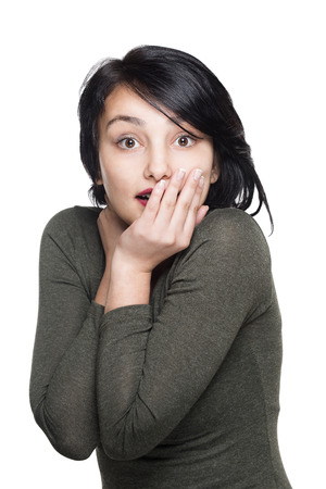 cheesy grin: Surprised beautiful young woman Stock Photo