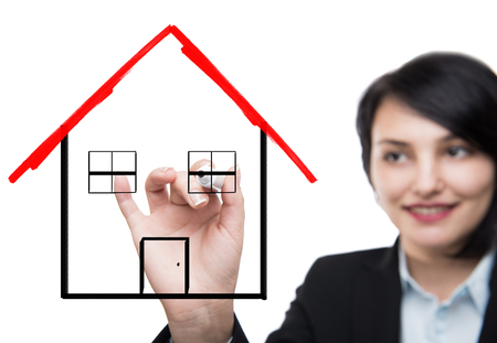 home ownership: Business woman drawing house