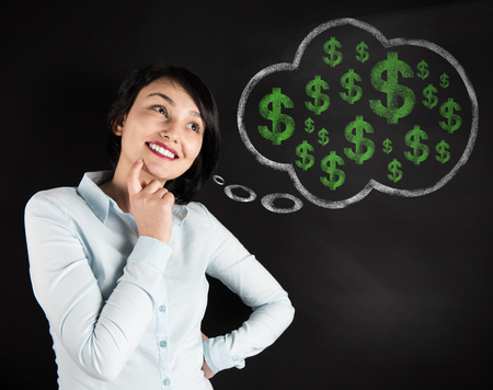 business attire teacher: Woman thinking about Money Stock Photo