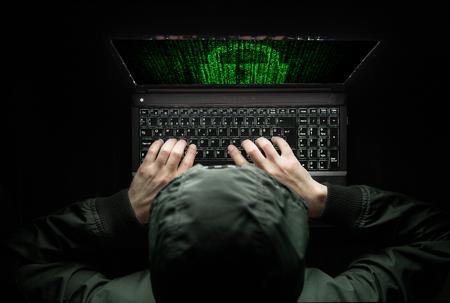 criminal activity: Hacker at work Stock Photo