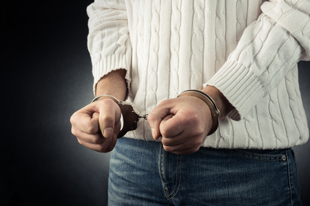 restraining device: The man is arrested and handcuffed Stock Photo