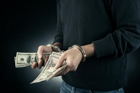 restraining device: Thief is handcuffed