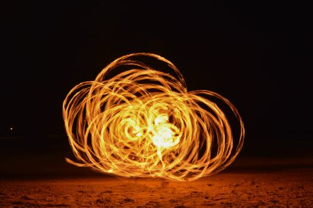 poi: Spinning Burning Poi Stock Photo