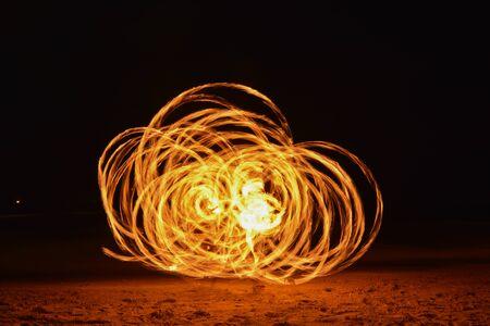 poi: Spinning Burning Poi Stock Photo