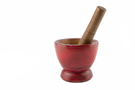 Wooden mortar and pestle isolated on white background photo