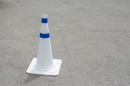 traffic   cones: White Traffic Cones on Road Stock Photo