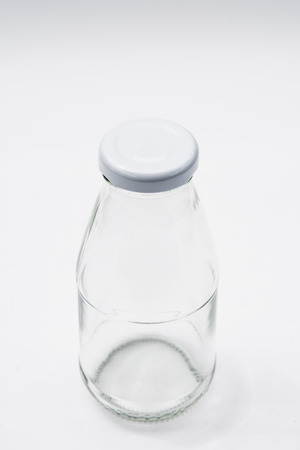 colorless: Empty colorless glass bottle on White Background Stock Photo
