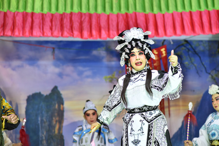 BANGKOK THAILAND - May 20, 2017: The Traditional Chinese Opera, actress performs on stage with theatrical costume and facial painting, This charity event established for public. Everyone can join this event.