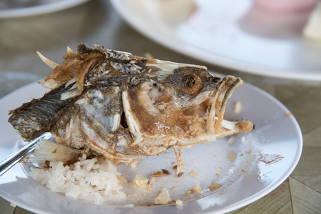 Head Skeleton of fried fish on dish, Its Delicious food