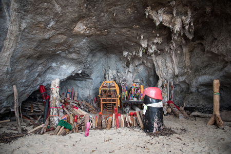 Wooden phalluses in Princess cave (Pranang cave). Ao Nang beach in Krabi. Thailand.