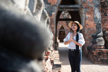 Tourists Trips and travel concept.. Young beautiful Asian tourist traveling in Thailand famous temple. Phra Sri Sanphet Temple, Phra Nakhon Si Ayutthaya, Thailand