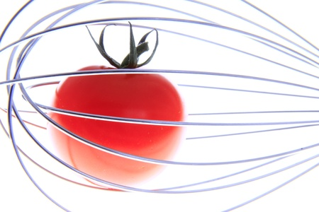 tomato in a whisk photo