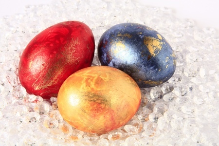 unorthodox: three colored Easter eggs in the colors red, blue and yellow  Stock Photo