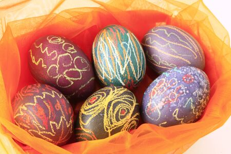 colorful Easter Eggs in a nest made from tulle photo