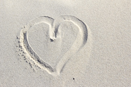declaration of love: heart painted in the sand of a dune