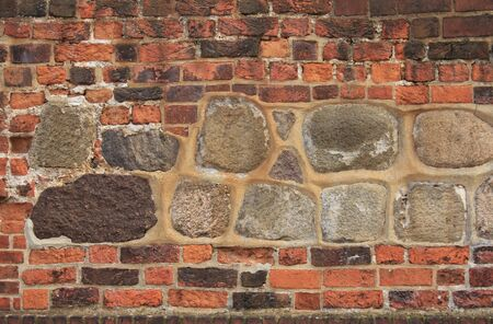 unevenly: decorative brick-work with bricks and natural stones