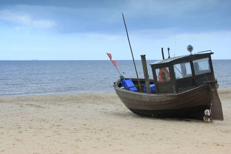 romantically: fishermans boat on the beach of the Baltic Sea