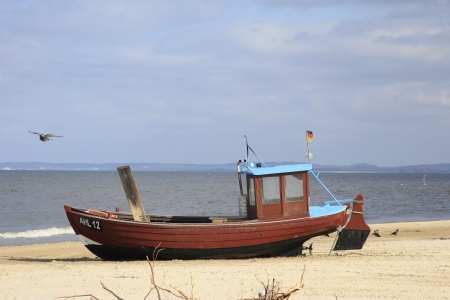 bank western: fishermans boat on the beach of the island of Usedom, Germany