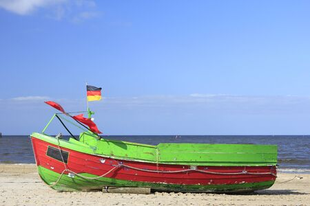 fishermans boat on the beach of the island of Usedom, Germany photo