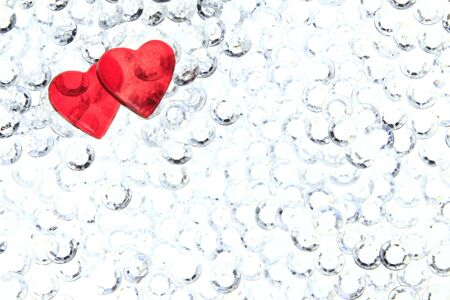 two red hearts on glitter stones - symbol for Valentine Stock Photo - 12114238