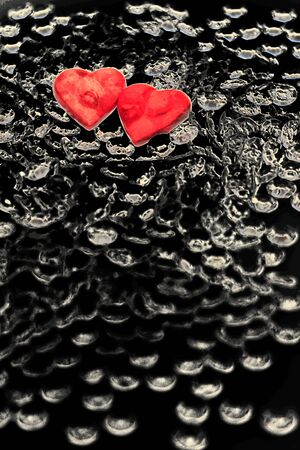 two red hearts on decoratively black background - symbol for Valentine Stock Photo - 12114244