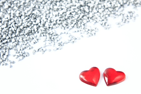 two red hearts before decoratively silver-grey gravel - symbol vor Valentine Stock Photo - 12114228