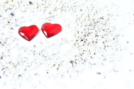 two red hearts with silver-grey gravel - symbol for Valentine Stock Photo - 12114230
