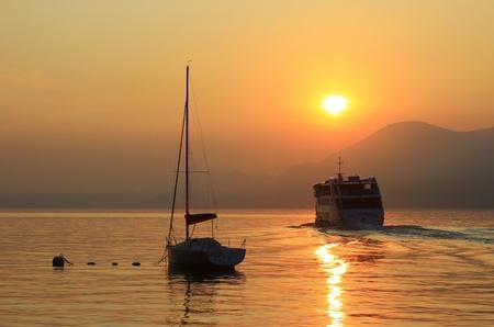 peacefully: sundown at the lake Garda, Italy