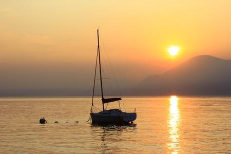 wavily: sundown at the lake Garda, Italy