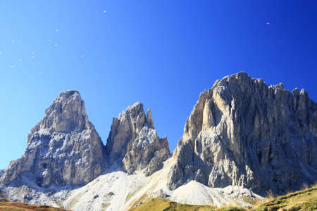 Paragliding over the peaks of the Dolomites (