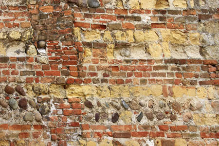 old wall with layers of red bricks photo