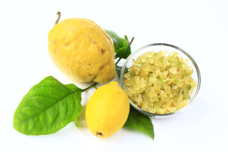 Citron (Citrus medica), lemon (Citrus x limon ) with candied lemon-peel and citrus leaves, cut out Stock Photo - 12415192