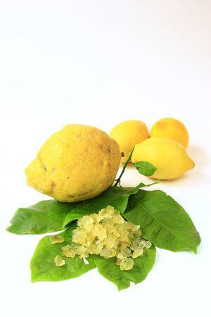 Citron (Citrus medica), lemon (Citrus x limon ) with candied lemon-peel on citrus leaves, cut out Stock Photo - 12415191