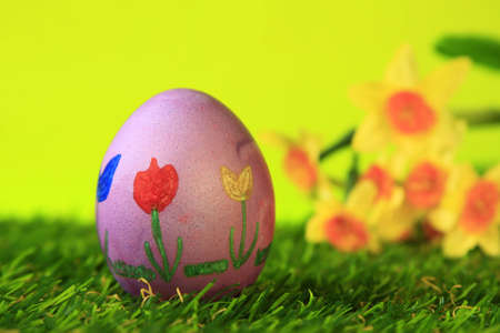 Easter decoration from single, colorful painted, Easter egg in green artificial grass Stock Photo - 12802847