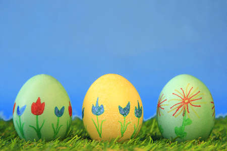 Three Easter eggs painted with flower motifs photo