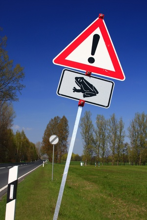 Road sign   Caution frogs   on a road in Germany photo