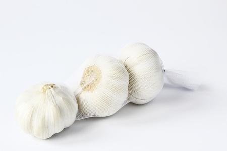 strikingly: Garlic, three bulbs before white background