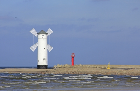 The historical mills beacon at the harbor entrance from Swinoujscie, Baltic Sea, Poland photo