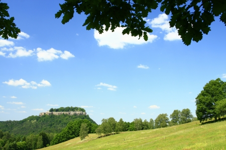 Landscape in Saxony with meadow, woods and blue skies and views of the fortress K�nigstein photo