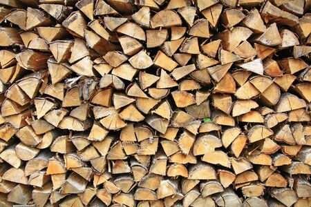 co2 neutral: stack firewood Stock Photo
