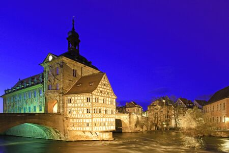 balthasar: The Old Town Hall of Bamberg, Bavaria, Germany on a very small island in the river Regnitz at night Stock Photo