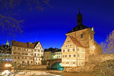 The Old Town Hall of Bamberg, Bavaria, Germany on a very small island in the river Regnitz at night Stock Photo